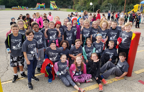 Students in walkathon tshirts on playground