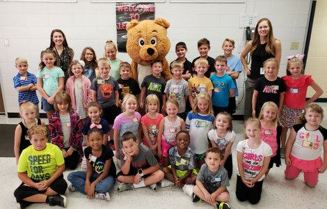 New students to JFD smile with Johnny Bear mascot