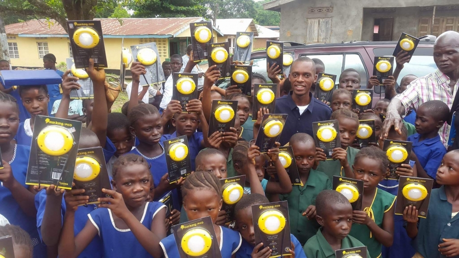 Students in Bumpe, Sierra Leone with their solar lanterns
