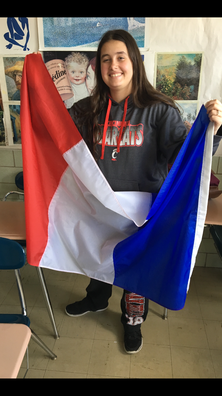 Photo of Jessica Morgan with French flag