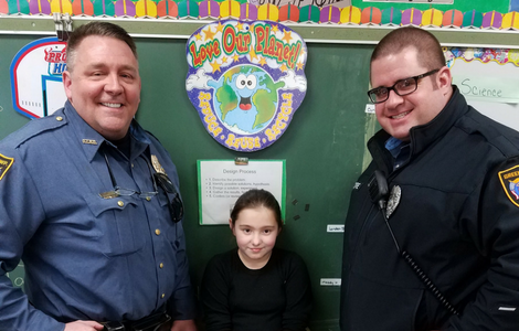 Green Township police smile with student