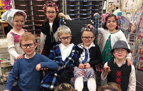Kindergarten students dressed as up as 100 year olds