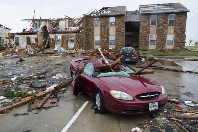 Damage to a car and Houses after Hurricane Harvey