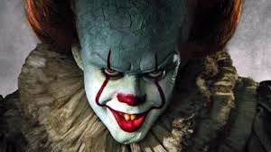 Pennywise the Dancing Clown staring Manically at the camera